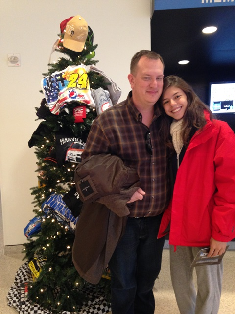 Photo of Bruna and Dane in front of Christmas Tree at Nascar Hall of Fame on Not So Mommy... Photo Gallery