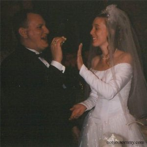 Photo of Brandi with her hand up, showing Dane not to smash wedding cake in her face! Gallery Photo on Not So Mommy