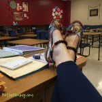 Photo of feet wearing colorful, cute shoes propped up on a desk in a classroom on First Day of School: A Teacher's Perspective Fashionista & Uniquely Me Blog on Not So Mommy