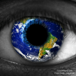 Photo of the world reflecting in a person's eye on Hosting a foreign exchange student - Should I host again Host Mom Blog on Not So Mommy