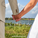 Photo of a newlywed couple holding hands on The Infertility Conversation: Should you talk before marriage Infertility and Wife & Home Blog on Not So Mommy