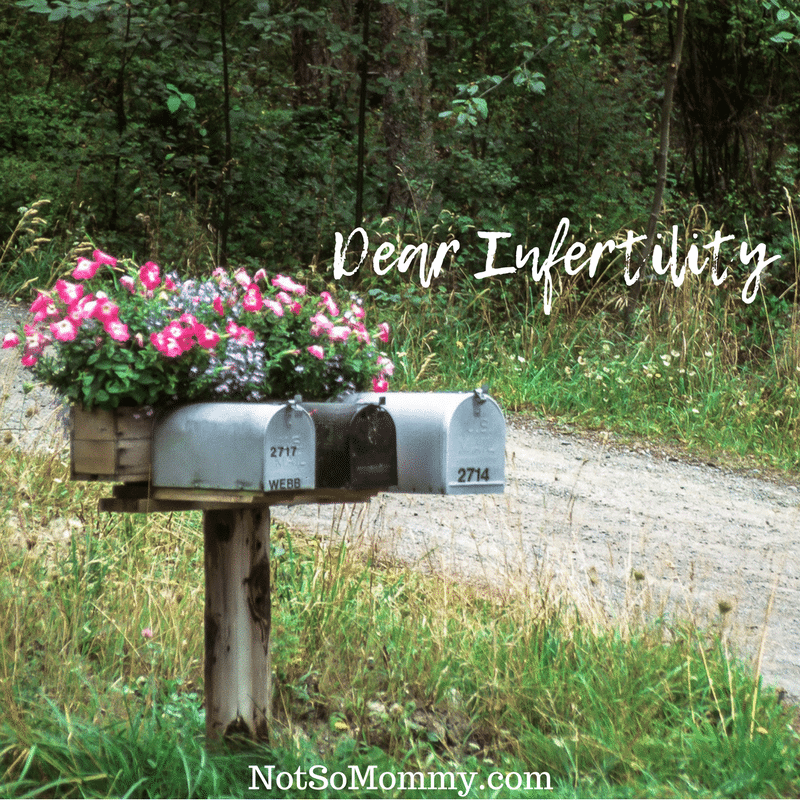 Photo of three mailboxes with flowerflox behind them on Dear Infertility, I want to break up Infertility Blog on Not So Mommy...