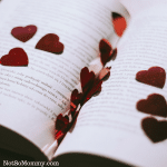 Photo of an opened book with red hearts scattered on the pages on Kind Words Good Things Blog on Not So Mommy...