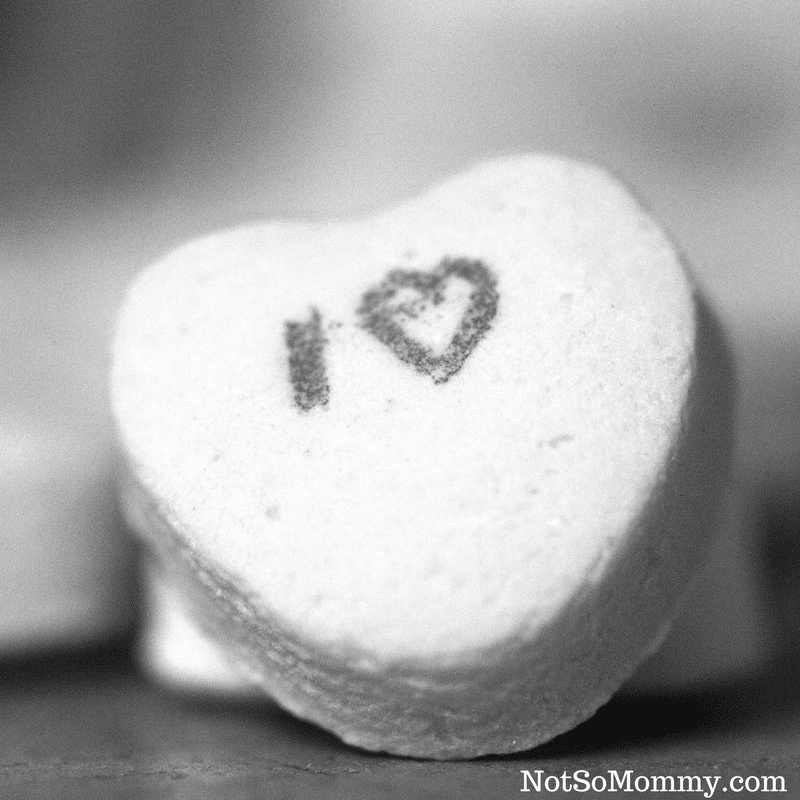 "Black & White Photo of a Candy Heart which says ""I love"" on The Problem with Being Childless: Where does the love go? Infertility Blog on Not So Mommy..."