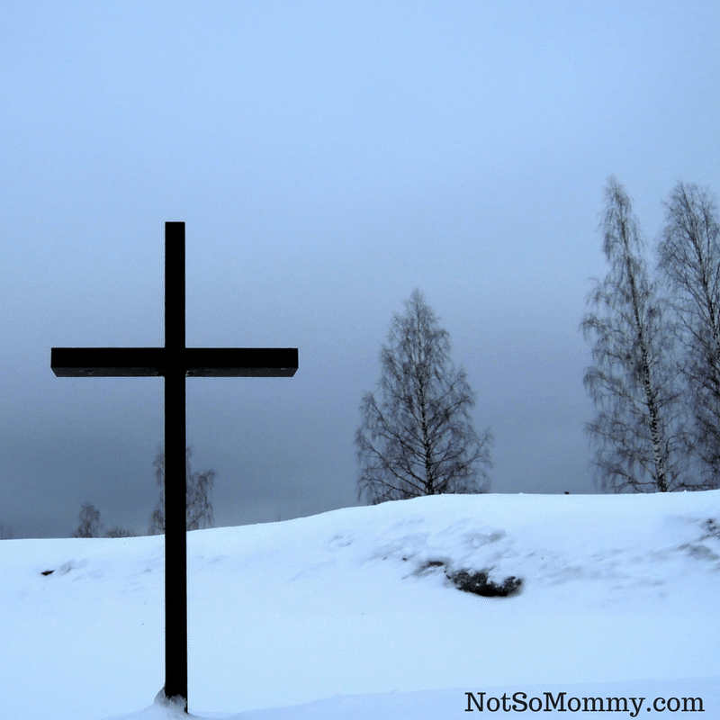 Photo of a cross on a snow covered mountain on Jesus was childless, too. Final blog in Childless Holidays Series on Not So Mommy...