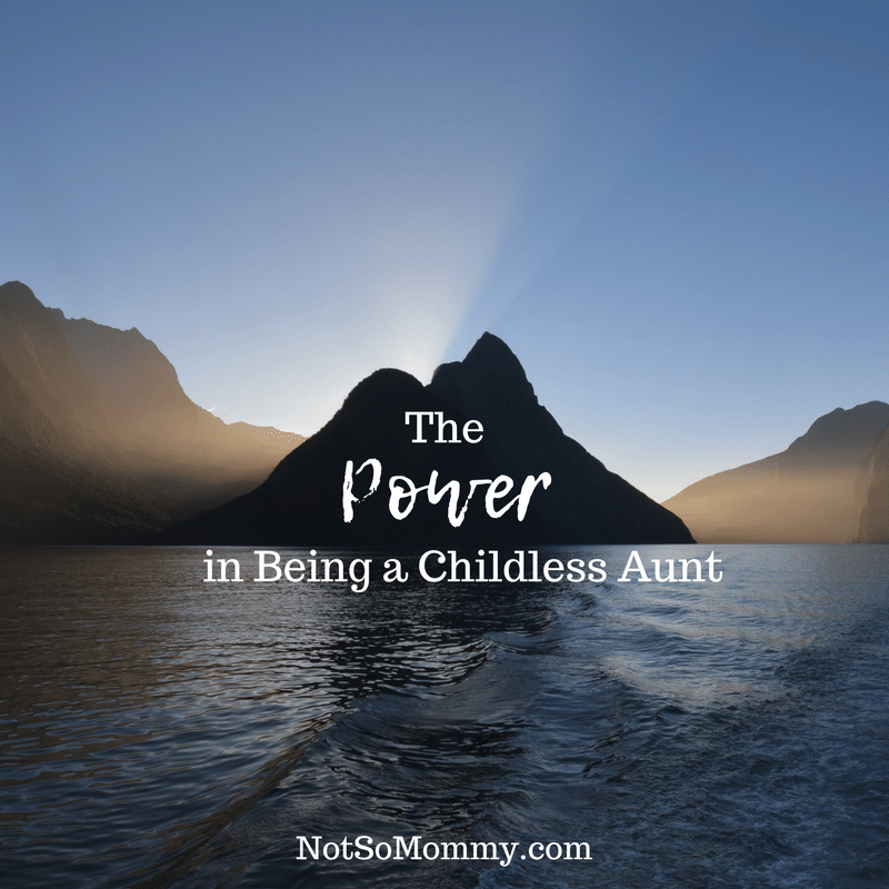 "Photo of a mountain rising up from the water with sunlight shining behind on ""The Power in Being a Childless Aunt"" on Aunt/Infertility Blog on Not So Mommy..."