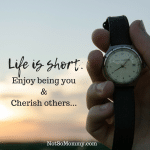 Photo of a hand holding a watch with the sunset in the background on Life is short. Enjoy being you & Cherish others on Uniquely Me Blog on Not So Mommy...