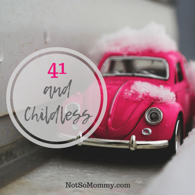 Photo of a bright pink VW Bug in the snow on 41 and Childless on Infertility / Childless Blog on Not So Mommy...
