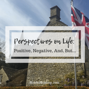 Photo of the British flag with a large stone house, small stone house, and Church in the background on Perspectives on Life: Positive, Negative, And, But... on Not So Mommy..., a Childless Blog