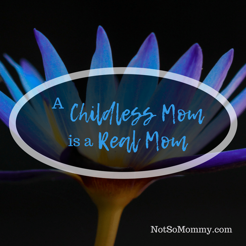 Photo of a single blue flower against a black background on A Childless Mom is a Real Mom on Not So Mommy..., a Childless Blog