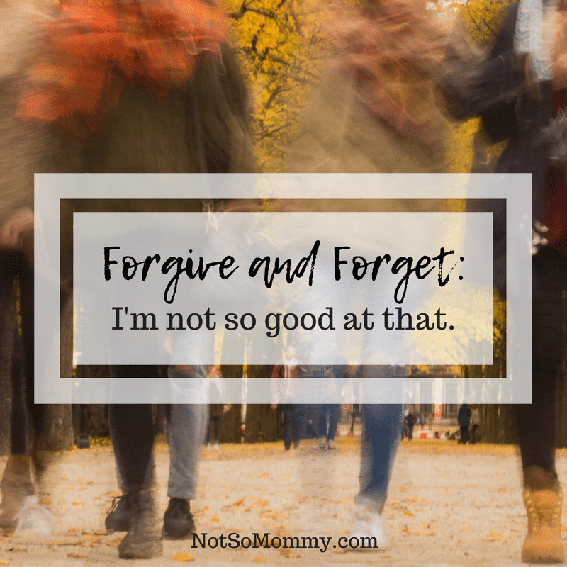 Photo of a group of people who are blurry walking along a fall pathway on Forgive and Forget: I'm not so good at that on Not So Mommy..., a childless blog