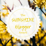 Photo of yellow flowers with sun shining on The Sunshine Blogger Award on Good Things Blog on Not So Mommy...