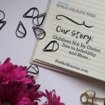 "Photo of pink flowers, black paperclips, and a notebook with ""Our Story: Childless Not By Choice Due to Infertility and More..."" written on it, on Not So Mommy..., a childless blog"