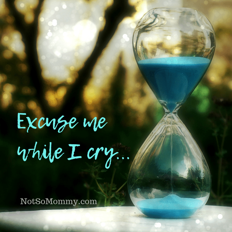 Photo of an hourglass with blue sand on Excuse me while I cry on Not So Mommy...