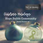 Photo of a clear Christmas ornament and a blue ornament sitting on the snow on Childless Holidays: Hope Builds Community on Not So Mommy..., a childless blog