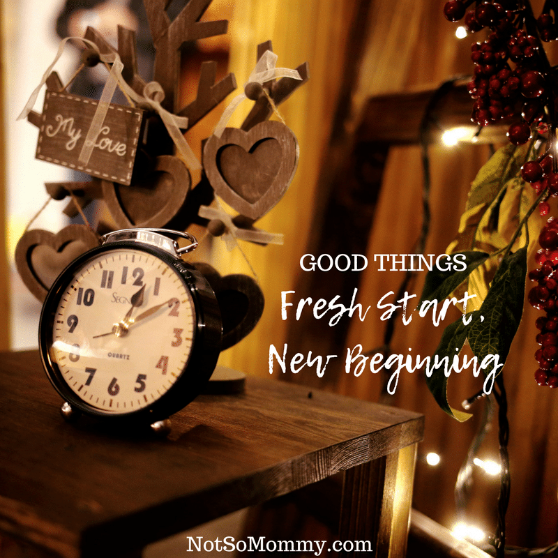 Photo of a clock showing 12:09 with berries and Christmas lights in the background on Good Things: Fresh Start, New Beginning on Not So Mommy...