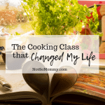 Photo of cookbook with several pages folder inward to look like a heart sitting on a kitchen counter in front of a window on Not So Mommy The Cooking Class that Changed My Life on Not So Mommy..., a Childless Blog