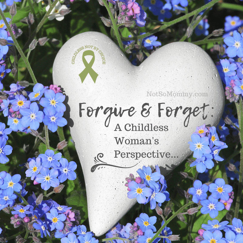 Photo of a stone heart nestled in forget-me-not flowers on Forgive and Forget: A Childless Woman's Perspective on Not So Mommy..., a childless blog