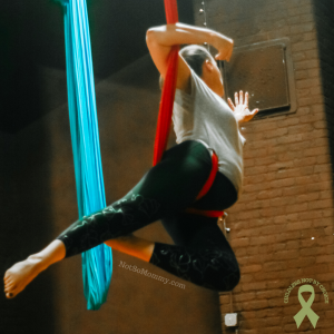 Photo of Brandi Lytle, founder of Not So Mommy..., performing aerial dance to The Breakup Song by Francesca Battistelli