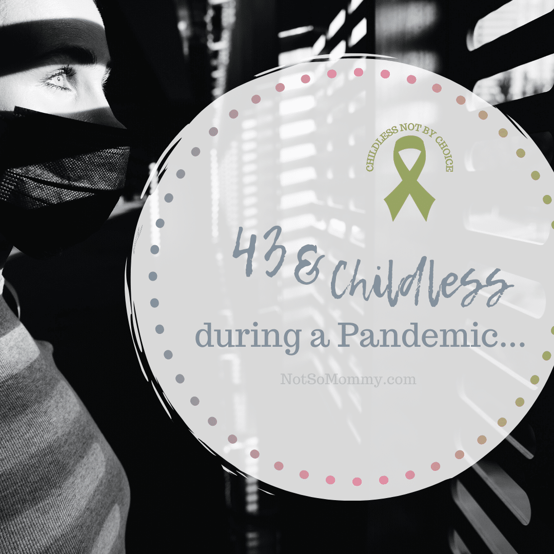 """Black & White Photo of a woman wearing a mask while looking out the window on """"43 & Childless during a Pandemic"""" on Not So Mommy..., an infertility & childless not by choice blog"""
