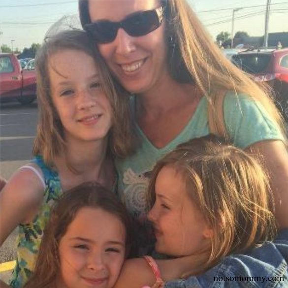 Photo of Tia Brandi hugging her three nieces on Not So Mommy More than an Aunt Blog
