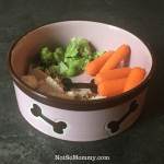Photo of Pink Dog Bowl with Brown Dog Bones filled with grilled chicken, brocolli, and baby carrots