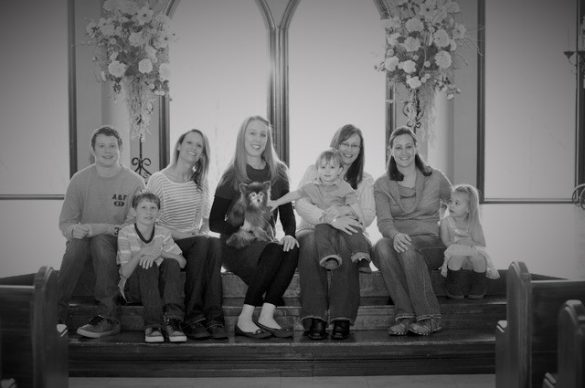 Photo of Brandi Lytle, of Not So Mommy..., with her fur baby, lifelong friends, and their littles
