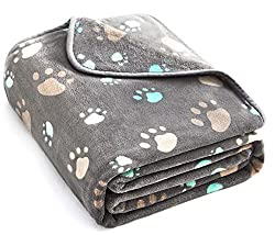 Photo of grey fleece blanket with paw print design available through The Not So Mommy... Shop for Fur Babies and Fur Mamas